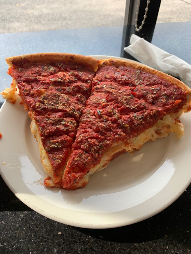 Deep dish slices from the Art of Pizza in Lakeview, Chicago. One of the best in the city and one of my favorite pizzas I've ever had.