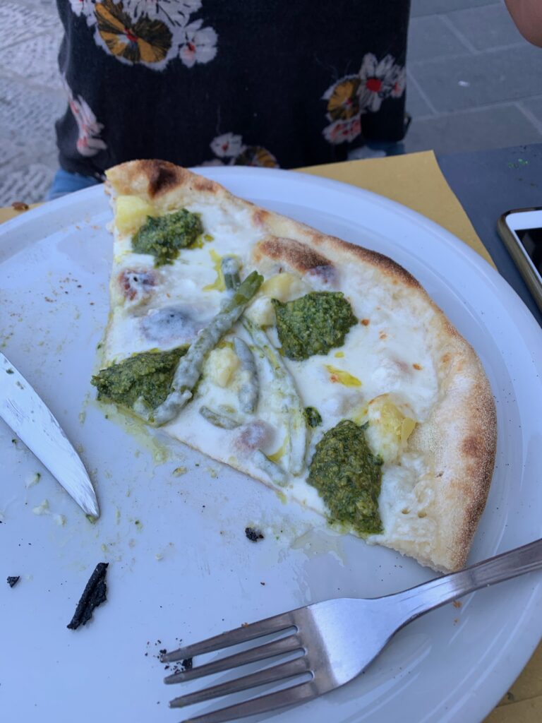 The Pesto Pizza at Molo Modo 21 in Genoa. It's the most unique pizza I've ever eaten. In addition to pesto it has stracchino cheese, green beans, and potatoes on it.