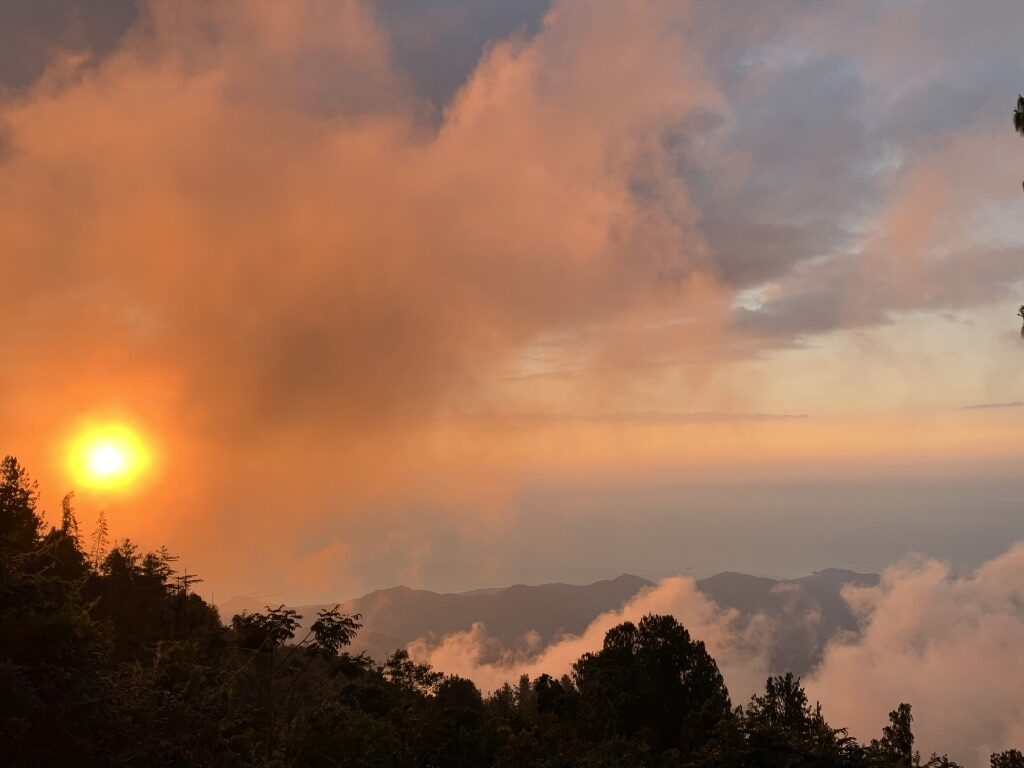 A sunset turns the sky orange in the mountains near Minca, Colombia